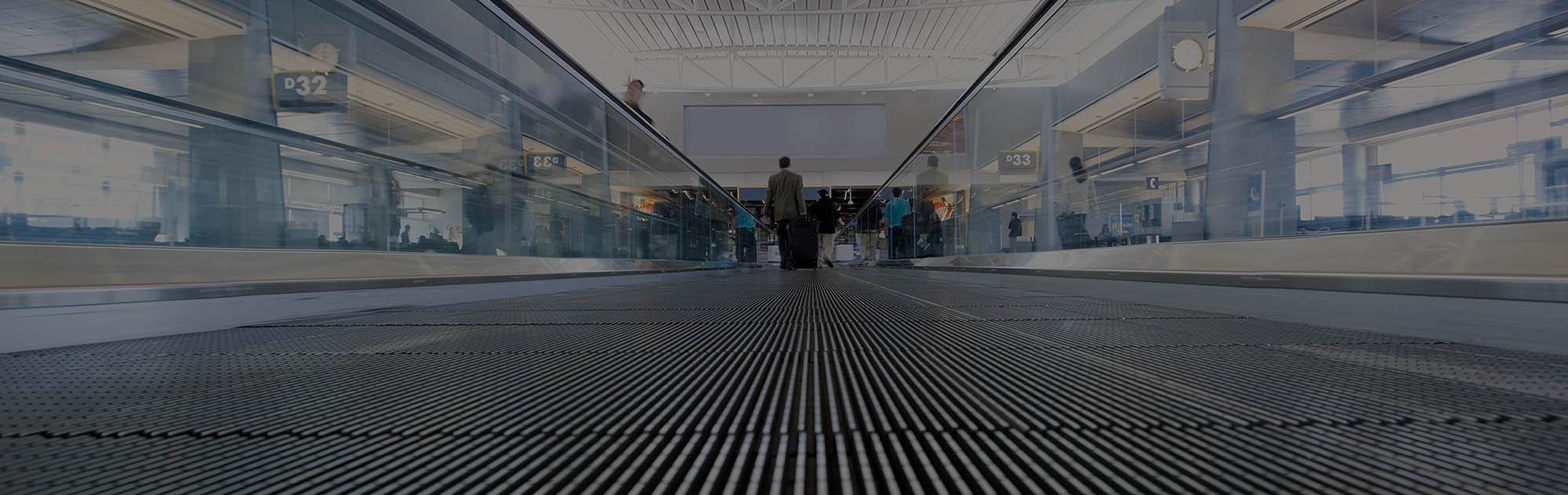 People walking on airport conveyor belt walkway